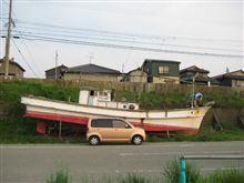 漁船とともに