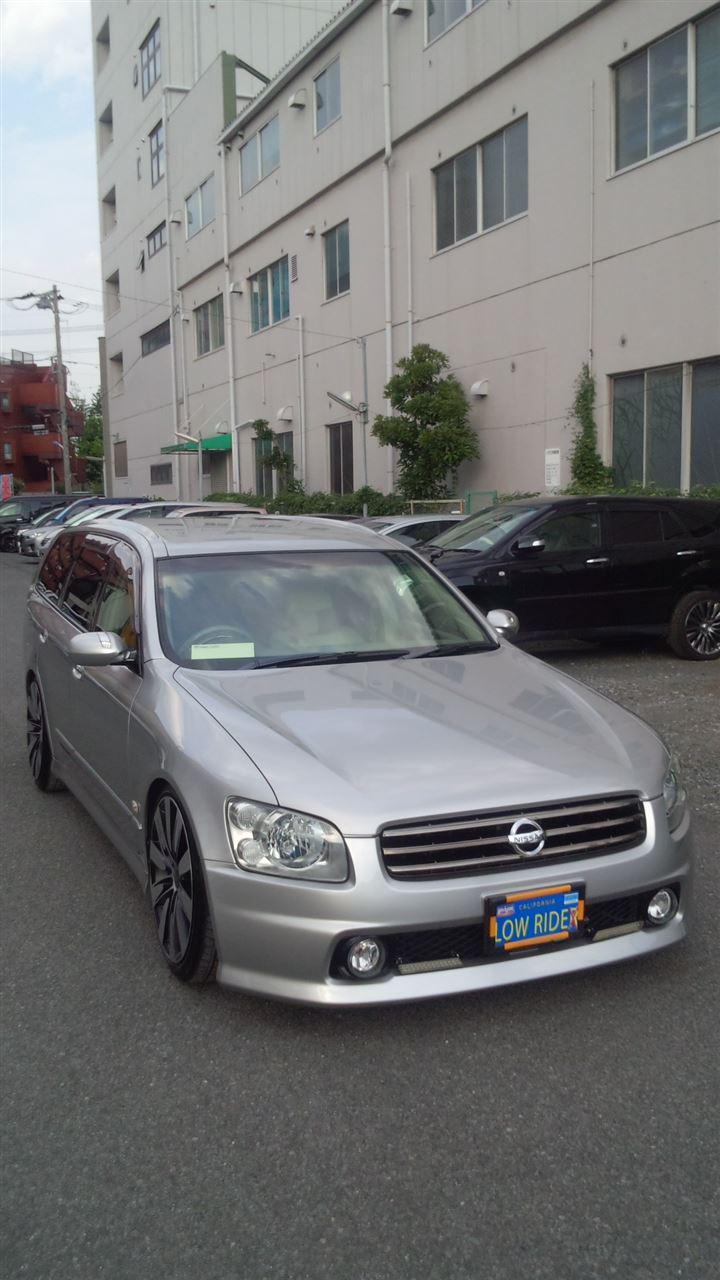 東京都立川市の車の板金塗装修理工場 ガレージローライドの日産 ステージアのリヤまわりのキズ へこみ の板金 修理 塗装 です。
