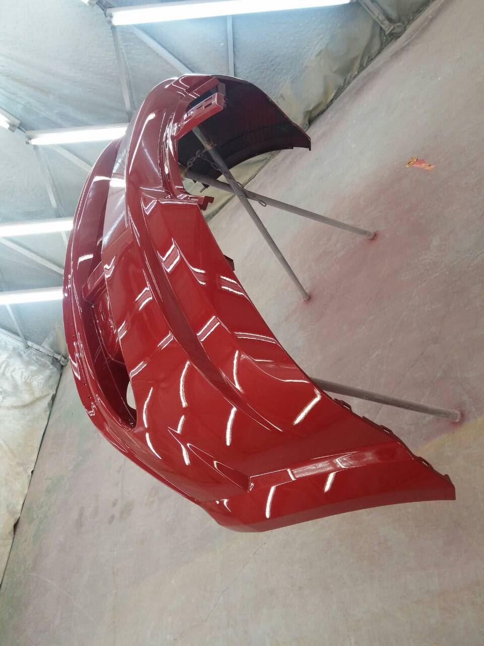 東京都立川市の車の板金塗装修理工場 ガレージローライドのクライスラー ダッジ JCの前まわりのキズ へこみ の板金 修理 塗装 です。