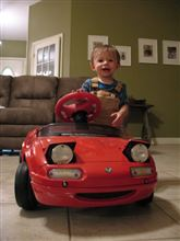 My second son Chris enjoy's his time with the NA Roadster pedal car. :)
