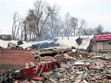 白人警官不起訴で荒れるファーガソン、略奪・破壊を受ける韓国人企業。