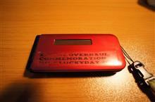 携帯ステッカー貼り換え。