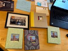 Making albums containing pictures of smiley students.