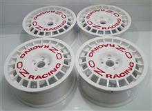 OZラリー16インチ100-5Hキャップレス加工パウダーグロスホワイト赤ロゴシール溶剤クリアー抑え無し