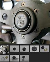 こんなの見っけ(MoMo Steering Wheel Leather Embossed Porsche Crest Horn Button)