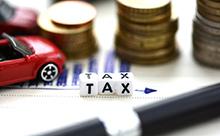 TAXロゴとコインの画像