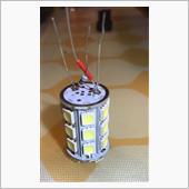 たかだか198円で購入したLEDのt20バルブ。<br /> 極性は一般的な++−−。<br /> タントの極性がレアな+−+−な為にムキになってバルブを分解し、バルブ台の位置を+−+−に変更したものの、ストップは点灯するがスモールが点灯しない問題。<br /> <br /> ハナから無極性なバルブ買えばいいのに、興味半分意地半分でのこの整備手帳。<br /> <br /> 知恵袋に質問しても、心ない返答で軽くあしらわれ、仕事中も何が起きてるか悩んで悩んで配線図まで書いて考えた結論は、ストップとスモール共に、LEDバルブから考えるとどちらもLEDプラスの同じところに繋がってるわけで。。。<br />