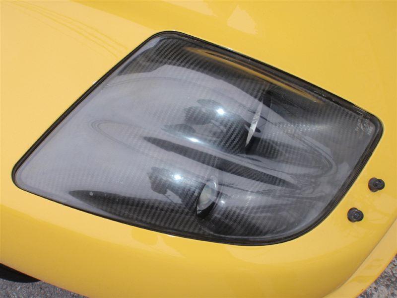 クーペフィアットPORCOROSSO ドライカーボン製ヘッドライトベゼルの単体画像