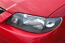 ファミリアS-ワゴンマツダ(純正) ブラックアウトヘッドライトベゼルの単体画像